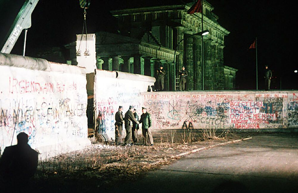 A section of the Berlin Wall is removed after the fall of Communism in Central and Eastern Europe.