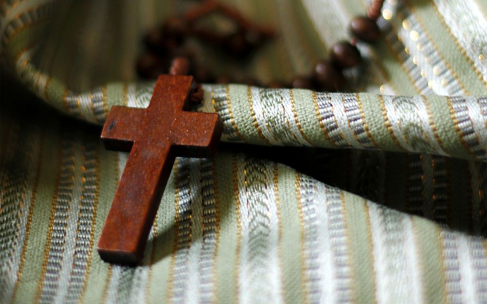 International: Wooden cross on Syrian fabric tells the story of Syrian Muslims coming to faith in Jesus. More Info