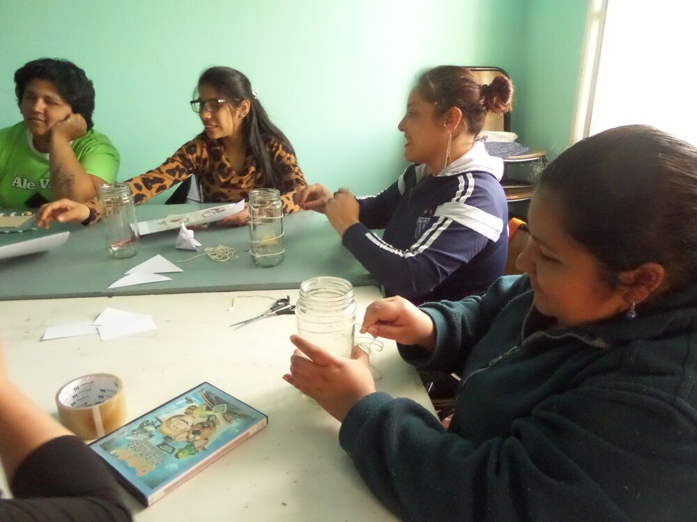 Women study the Bible at a craft workshop in Las Violetas, Cordoba.