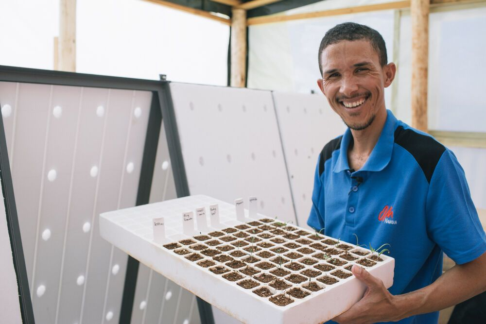 Namibia: Rodrieck Snyders with seedling plants for new Aquaponics project in Namibia More Info