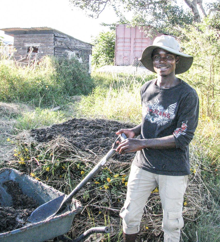 Zambia: Moses building a compost pile at OM Zambia model farm More Info