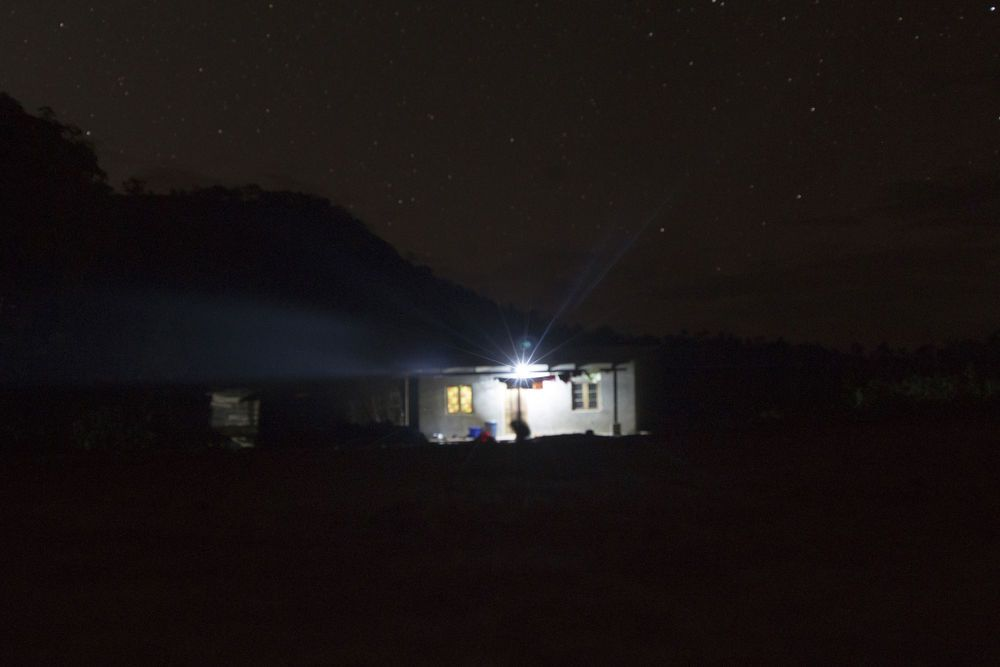 Malawi: OMer MacDonalds house lit up at night. More Info