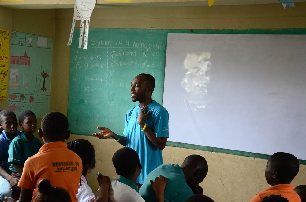 Ghana: Godfred talking to kids at PG School in Kumasi, Ghana More Info