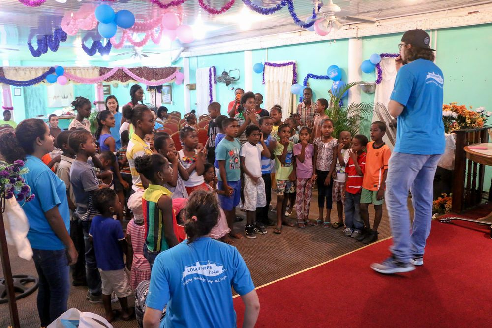 Guyana: Georgetown, Guyana :: Gustavo Cardoso (Brazil) explains a game to children during a kids event. More Info