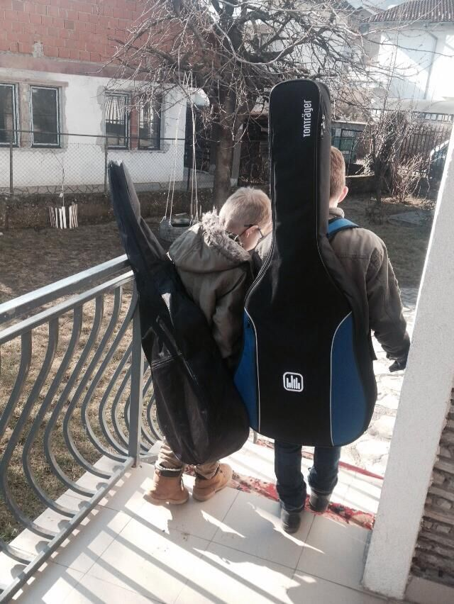 Sali and Besim from the House of Joy headed off to their music lessons.