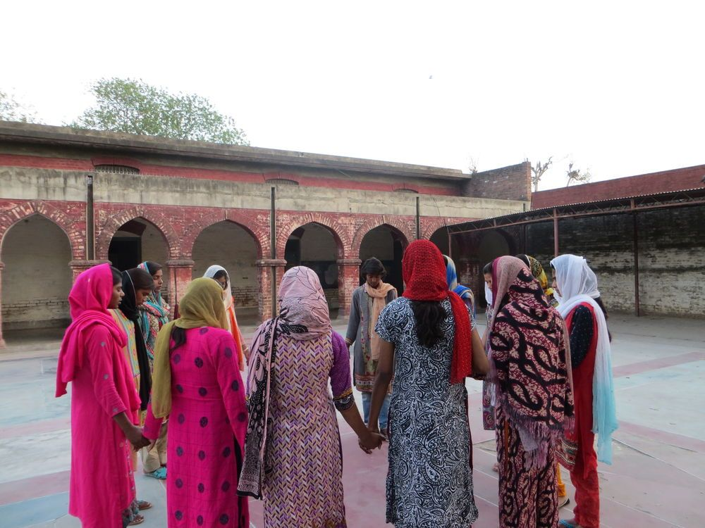 Pakistan: A group of teenagers praying after meeting with OMs womens team. More Info