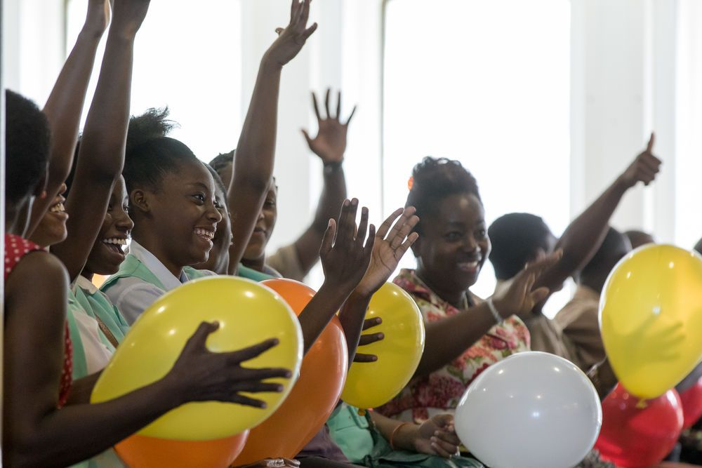 Kingston, Jamaica :: Students hold balloons to feel the vibrations during a percussion performance at an onboard event for deaf youth in Kingston.