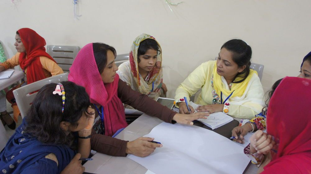 A group of women study during a Bible Training Camp.