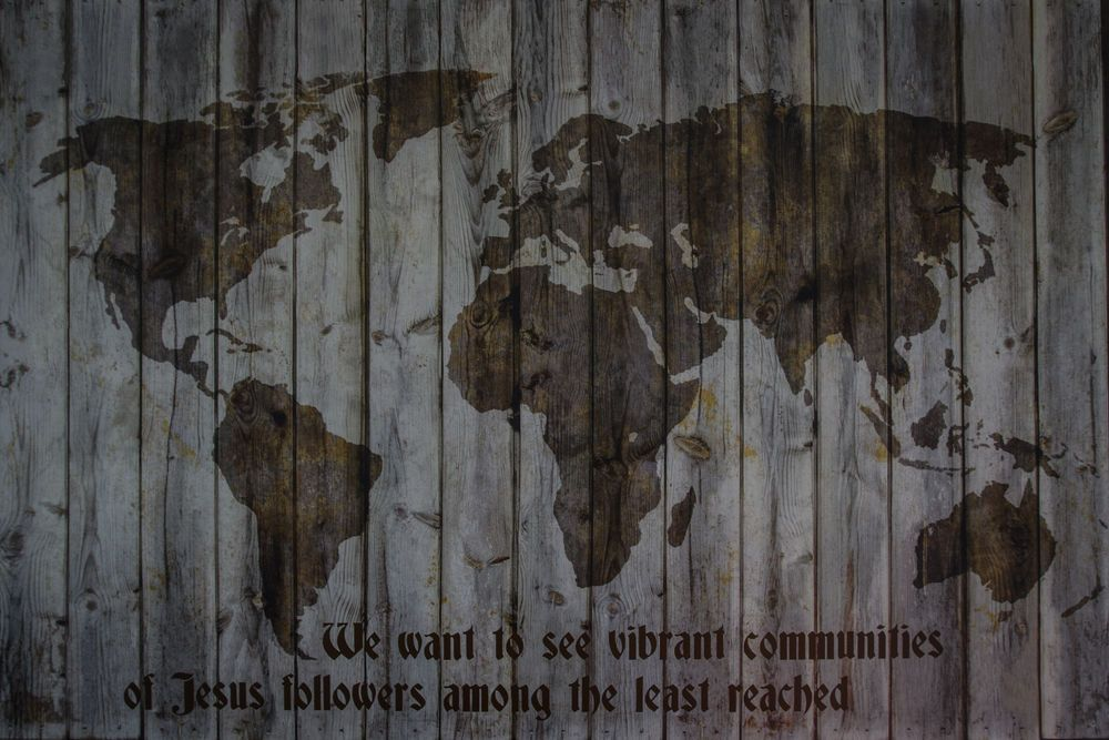 A wooden up-cycled map of the world hanging in OMs base in Moldova, with an inscription of OMs new mission statement: We want to see vibrant communities of Jesus followers among the least reached.  Photo by Garrett N.