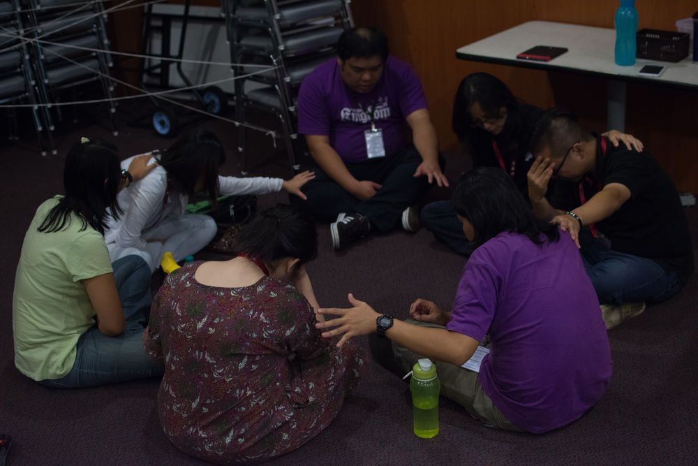 Malaysia: A group gathers together to pray for each other during Out of the Comfort Zone Asias opening night service. More Info