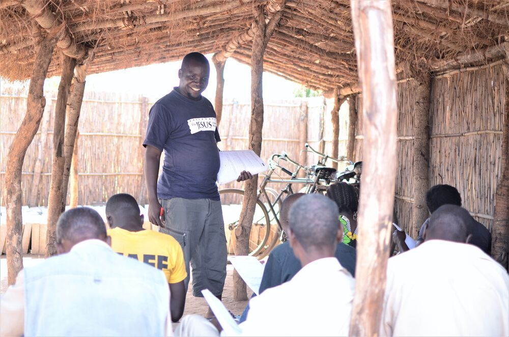 Malawi: Macdonald teaches some students about Bible study and context. More Info