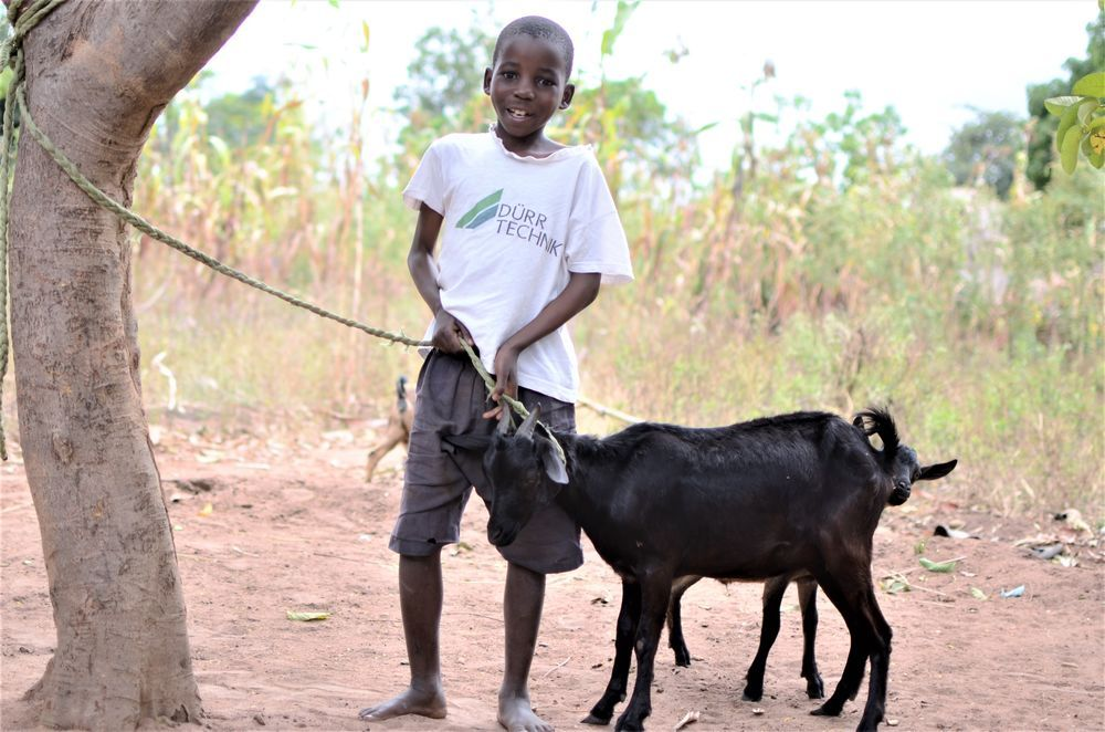 A student at Chiyembekezo school in Ntaja shows off the goat he received from OM Malawi