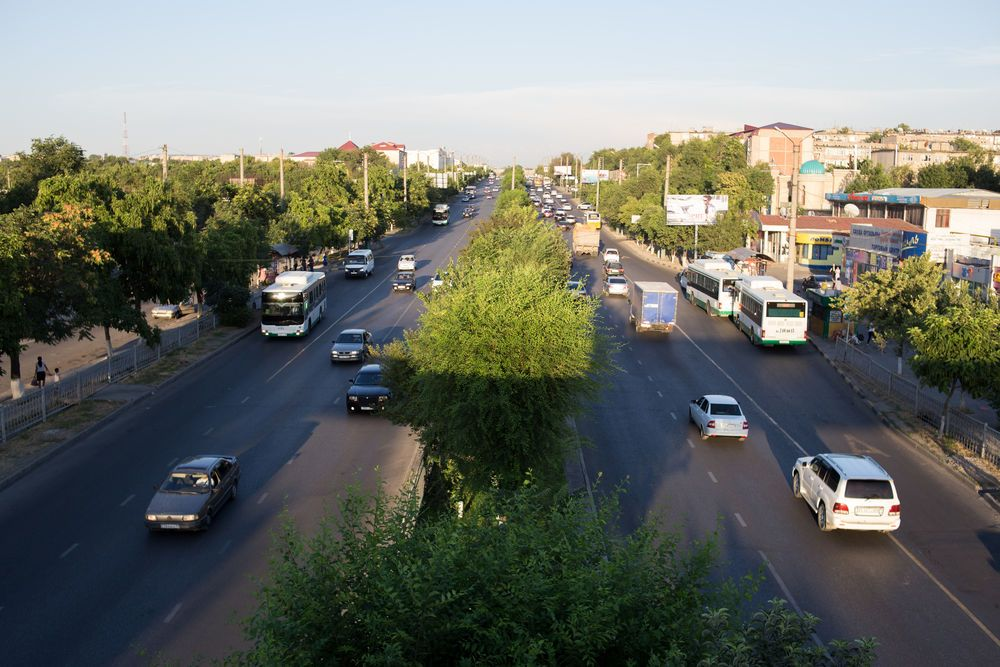 Central Asia: Traffic flows on a wide tree-lined city street in Central Asia. More Info