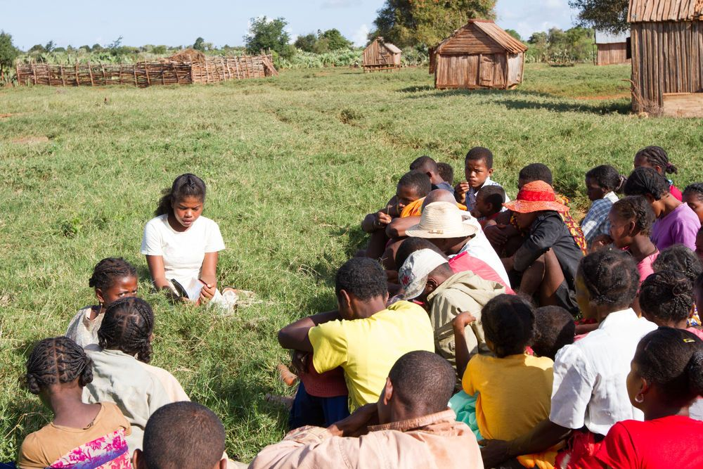 Madagascar: Sinorie, in white, gave her life to Christ after the OM team in Madagascar visited her village. Now she leads Bible study weekly and travels to other villages to spread the Good News. More Info