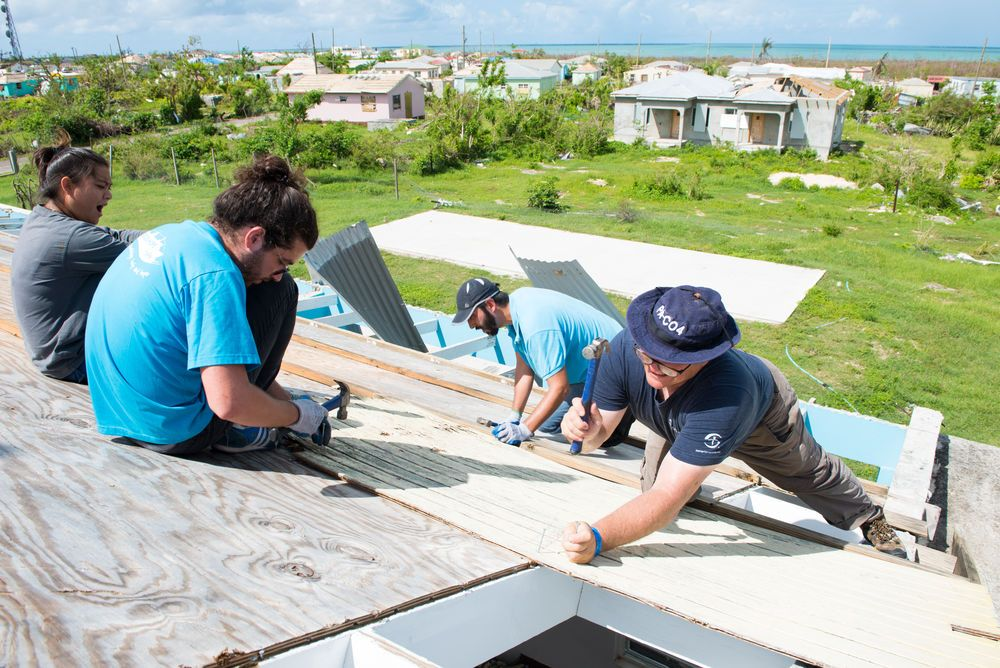 St. Johns, Antigua and Barbuda :: Crewmembers fix the roof of a building alongside volunteers from Samaritans Purse.