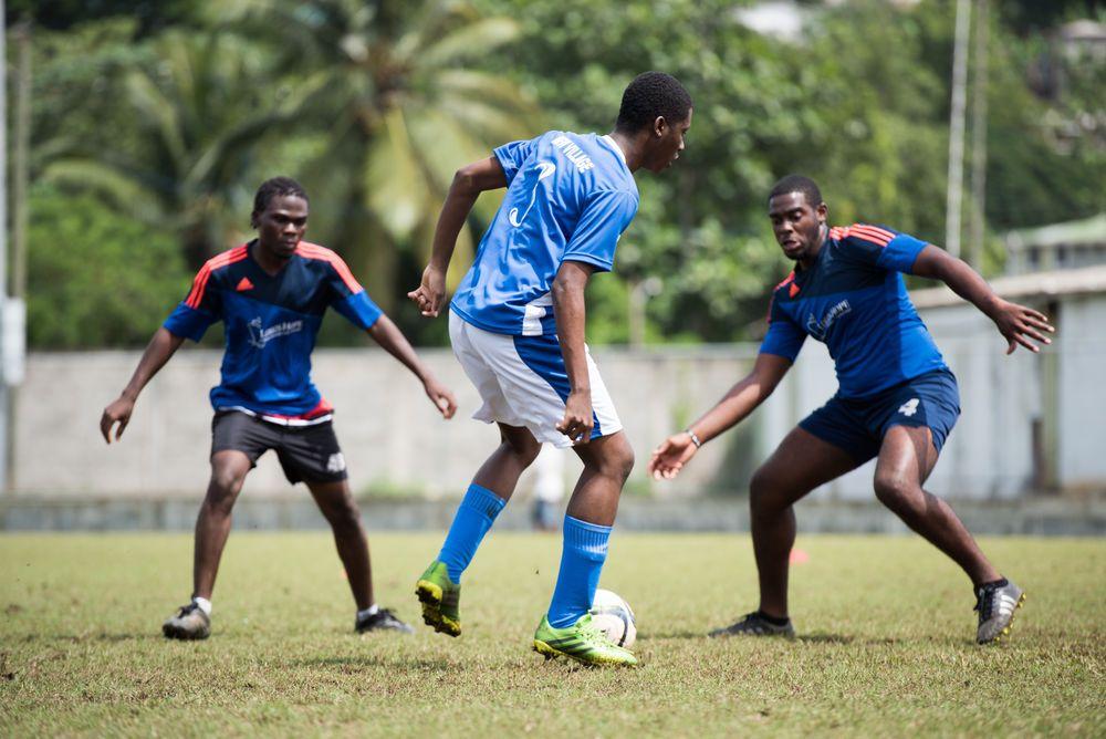 Saint Lucia: Castries, St. Lucia :: Crewmembers play football against a local team. More Info