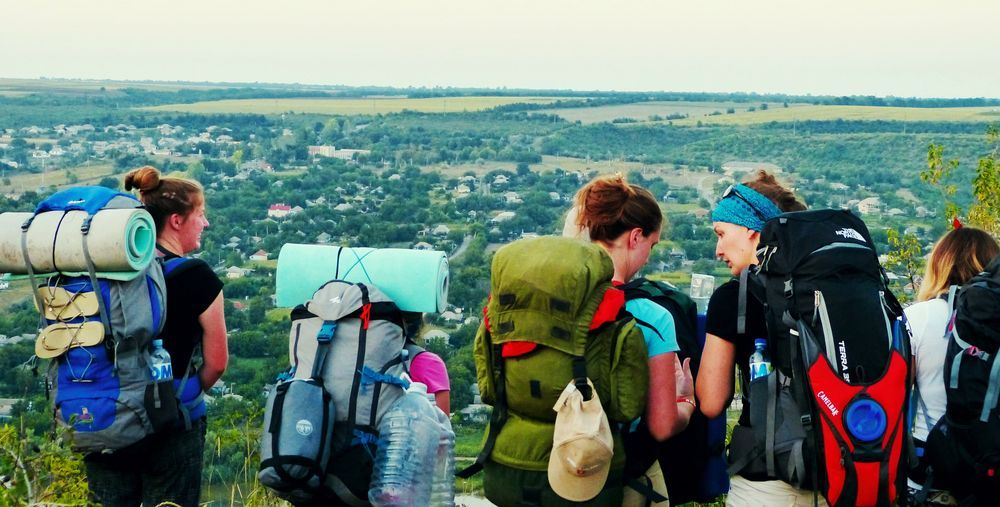 A trekking team on its way, climbing the hills overlooking a Moldovan village. During OM?s ?Love Moldova? summer outreaches, teams are trekking, cycling or rafting to some of the least reached places of the country, sharing God?s love as they run children?s camps, build playgrounds or visit the poor and neglected, bringing material help as well as encouragement and hope.