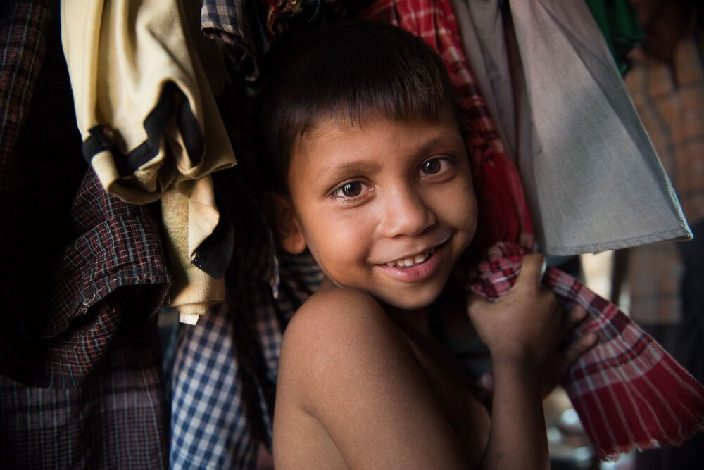 Bangladesh: A Rohingya child in his tent. The refugees are in a camp near Coxs Bazar in Bangladesh. Refugees are fleeing what the United Nations are calling ethnic cleansing in Myanmar. More Info