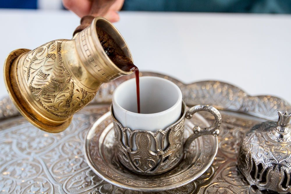 United States: A woman serves Turkish coffee. More Info