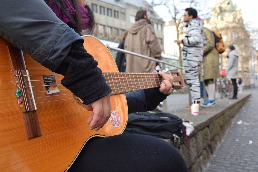 As ?Karneval?-goers decked out in their craziest costumes and flooded the bars in town, Riverboat community members armed themselves with flyers, the Gospel of John and a guitar, heading out on the streets to pray.