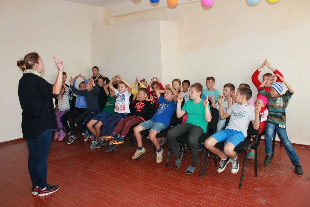 """Moldova: A participant of OM Moldova's """"Challenge into Missions"""" training leads a programme for underprivileged children during an outreach in a Moldovan village. The 10-week training course offers young Moldovans their first experience of missions. Seeing how God can use them, many participants are mobilised to continue in local or global missions. More Info"""