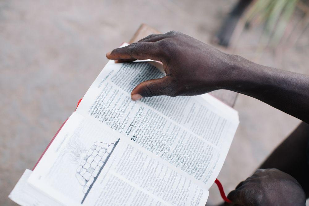 Man reads a Bible.