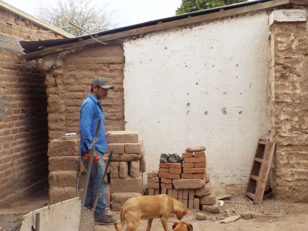 Mexico: A worker walking outside of his house in a little town in the north of México. More Info