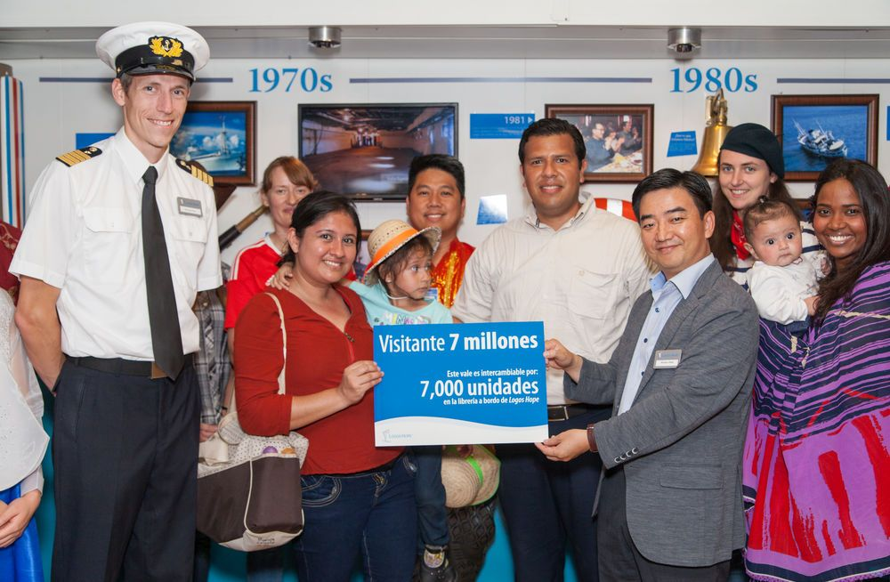 Mexico: Veracruz, Mexico :: Director Pil-Hun Park (South Korea) and Captain Samuel Hils (Germany) present a gift voucher to celebrate the arrival of the seven millionth visitor on board Logos Hope. More Info