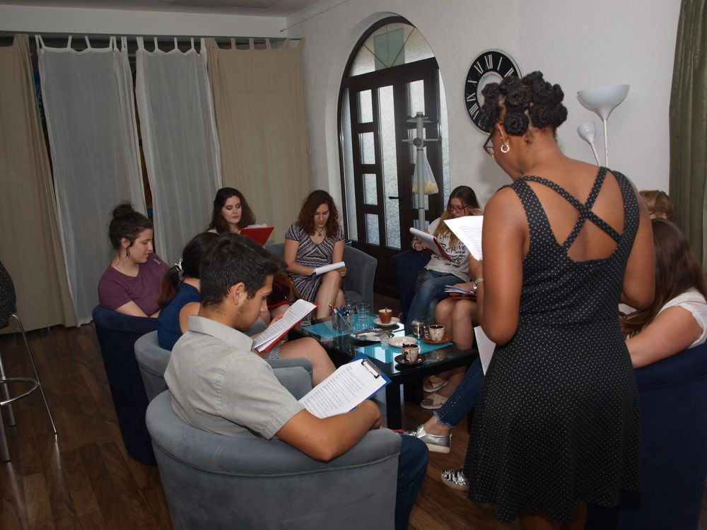 Young people gather for the English Cafe at OMs base The Living Room in Bar, Montenegro.