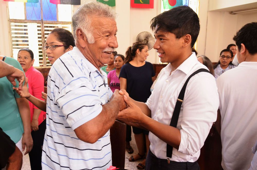 Mexico: Tampico, Mexico :: Michael Bukit (Canada) greets a man at a local church. More Info