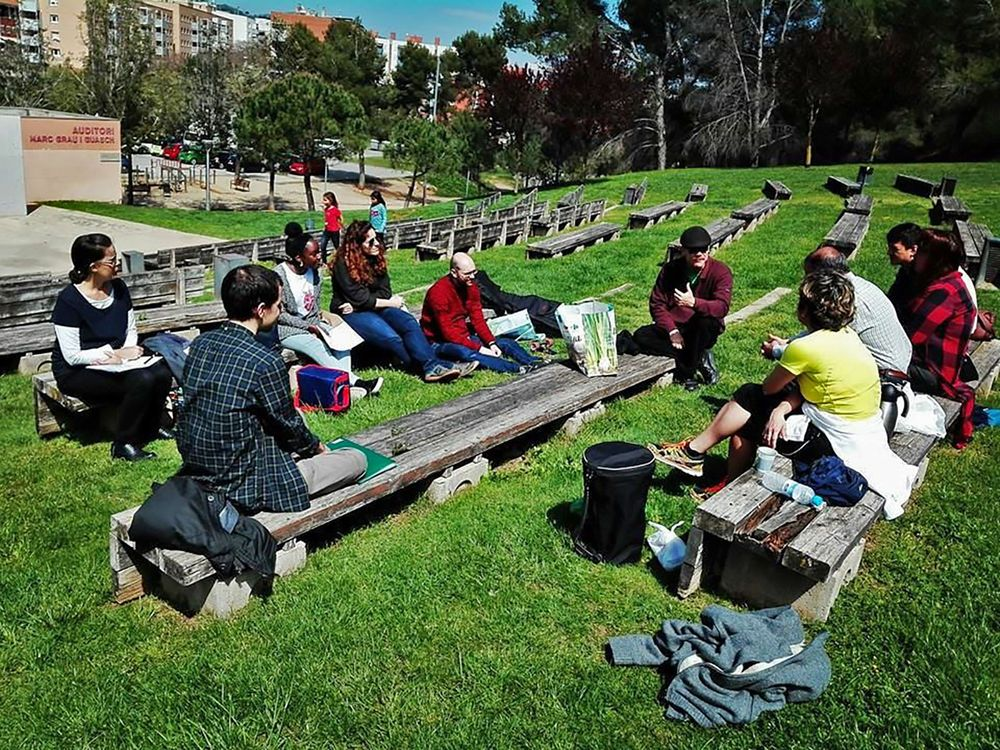 The OM team plants Gods seeds in Catalonia by giving out toasted corn in parks.