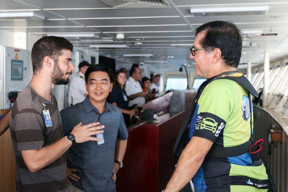 Mexico: Coatzacoalcos, Mexico :: Karsten Hassman (Spain), Director Pil-Hun Park (South Korea) and the Mayor of Coatzacoalcos talk on the bridge as Logos Hope arrives in port. More Info