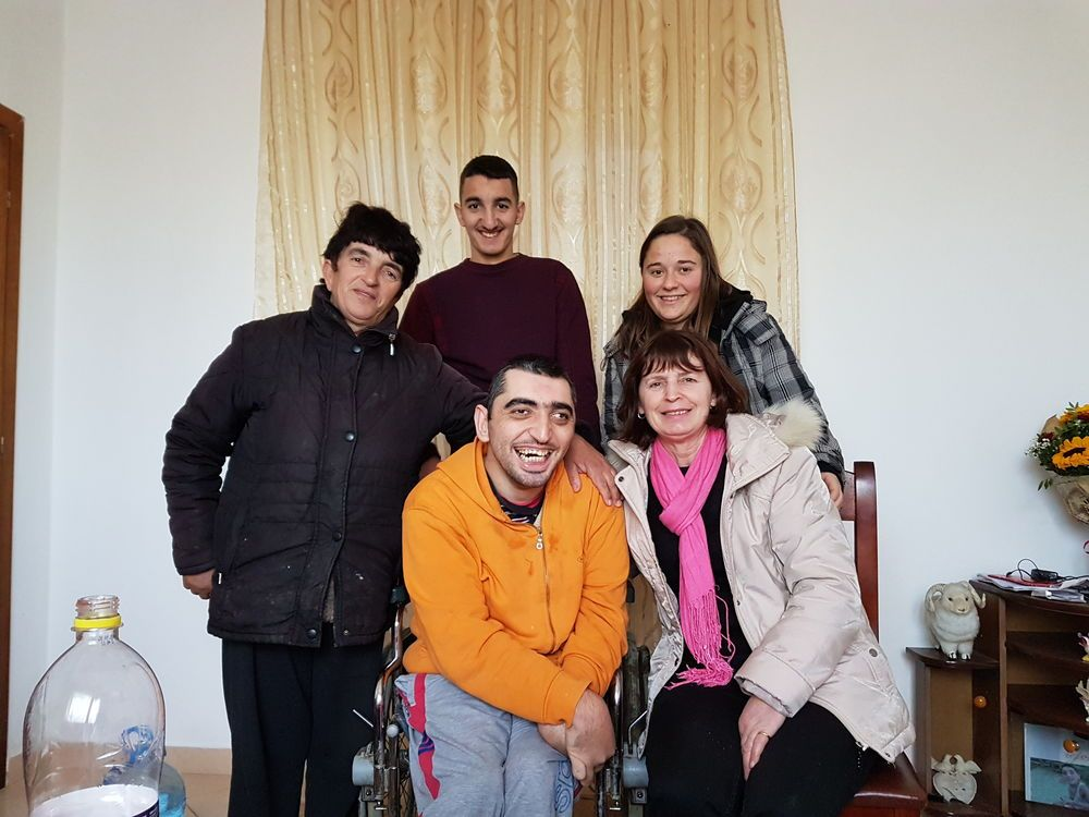 OMer and a local church member visit an Albanian family who has a special needs family member.