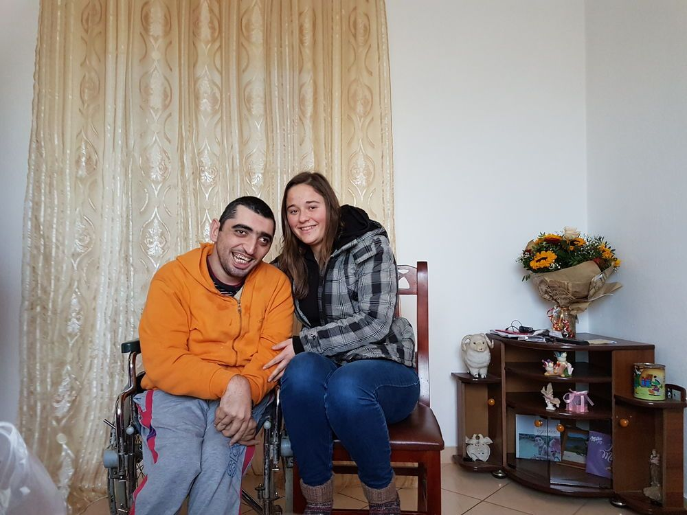 OMer visiting a precious special needs man; visiting is an important part of the Special Needs Ministry in Albania.