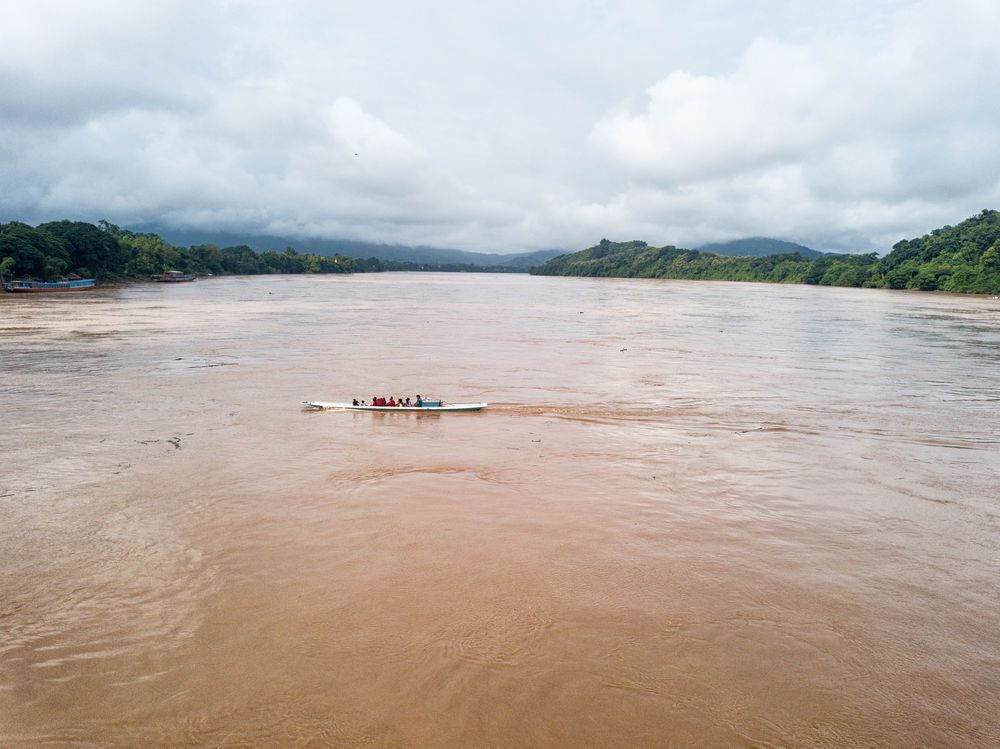 Laos: Ferries taking people and vehicles across the Mekong River. More Info