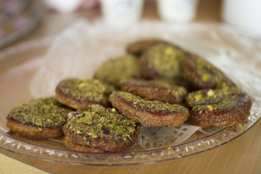 A typical local treat with helua and crumbled pistachios on top, in the Arabian Peninsula.  Photo by Kathryn Berry