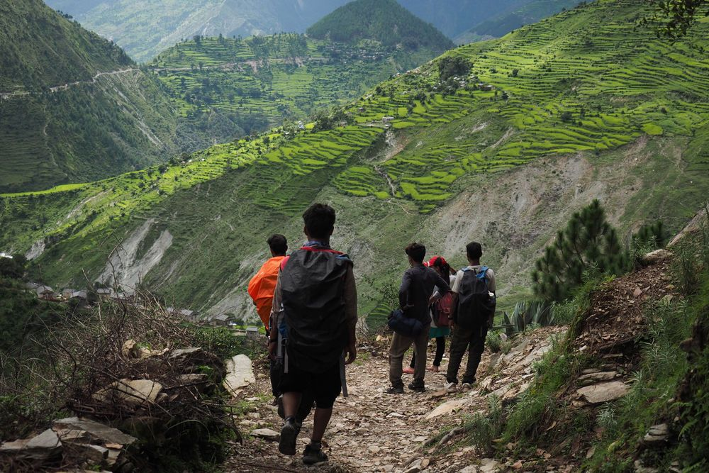 An OM team trekking through the mountains during their outreach time in remote areas.