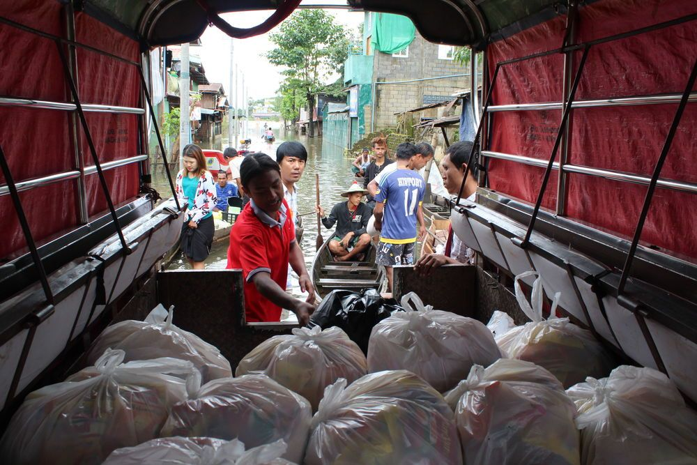 OM team members in Myanmar partnered with a local church to distribute emergency relief bags, with rice, oil and other non-food items to flooding victims in southern Myanmar.