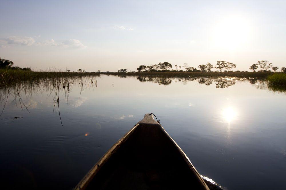 A canoe paddles on a lake.