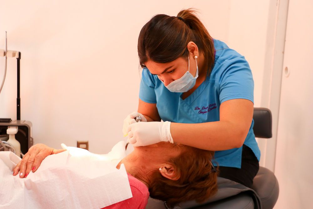 Antofagasta, Chile :: Alongside crewmembers from Logos Hope, a dentist gives free dental care to a community.