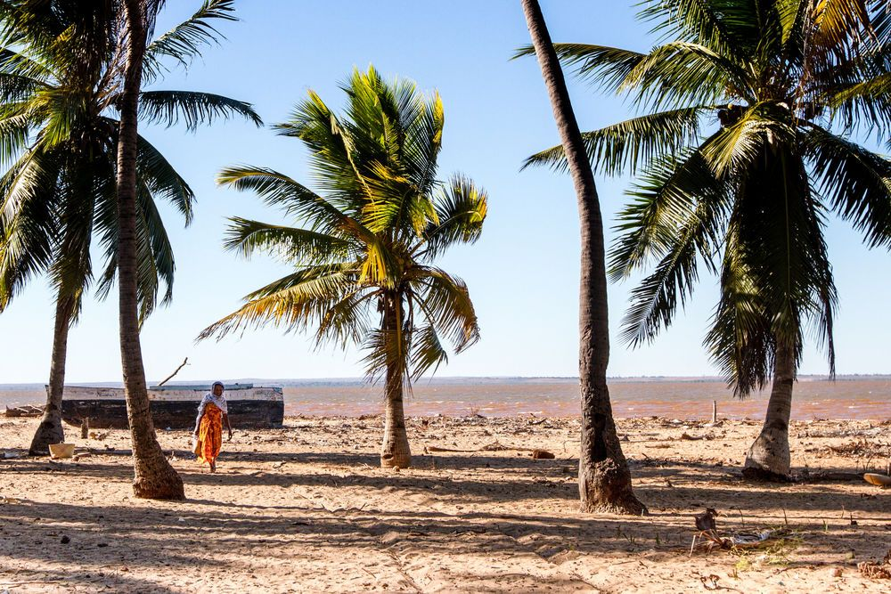 Madagascar: A woman walks along the beach in northern Madagascar. Photo by Rebecca Rempel. More Info