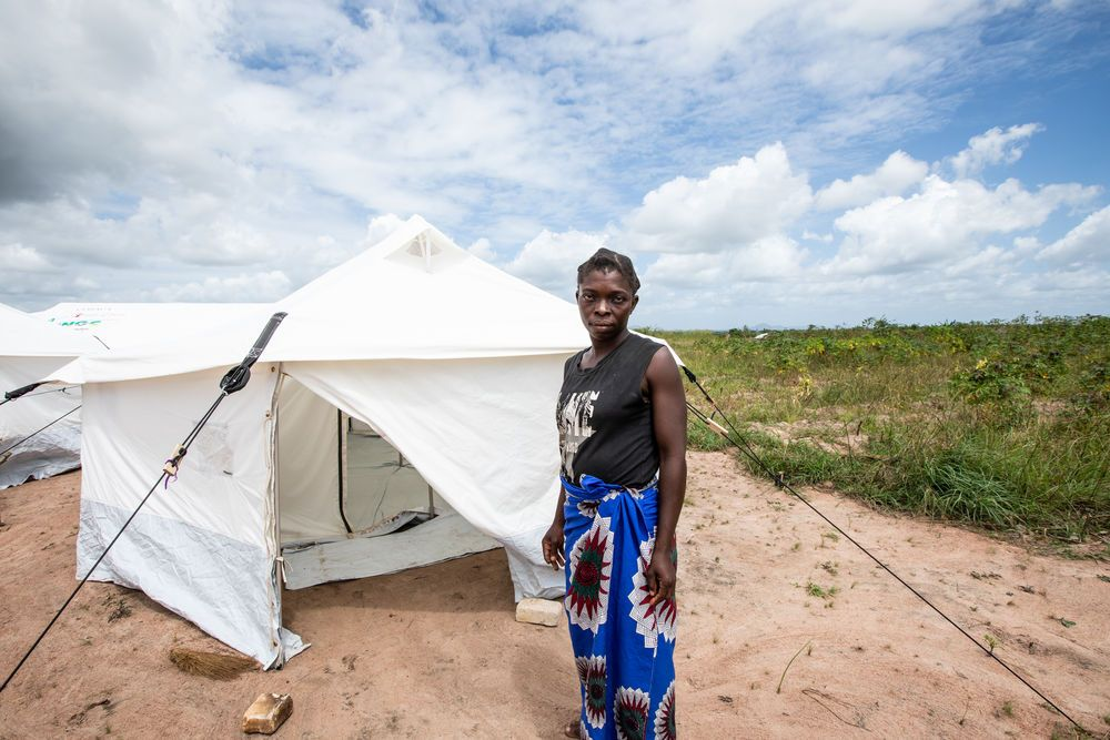 Amina, a widow and mother of five, by her tent. Aminas house, which used to be by the river, was destroyed by Cyclone Idai in Mozambique. She and her family have moved to a tent provided by the government on the outskirts of town. Photo by Rebecca Rempel.