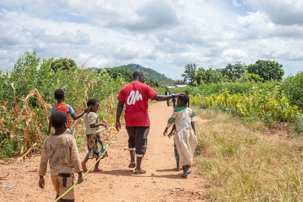 OM worker talking with people in villages in Malawi that were impacted by Cyclone Idai. Photo by Rebecca Rempel