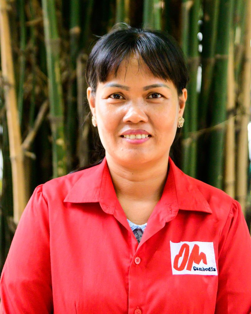 Cambodia: Portrait of Mom outside the local office. More Info