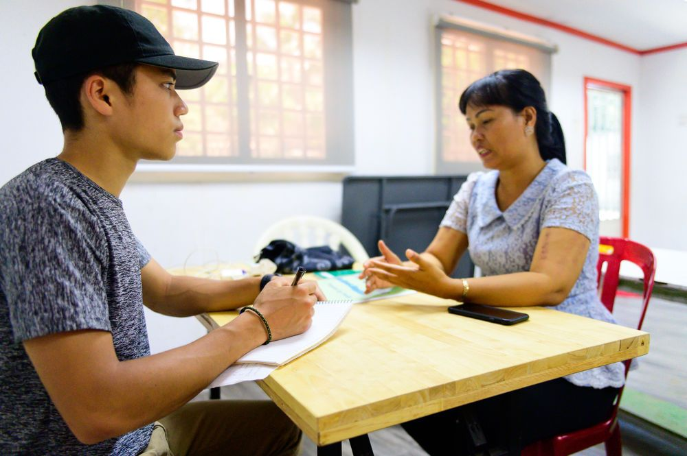 Journalism intern Chris Kuo interviews local people in Asia.