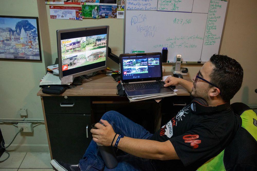 Costa Rica: OM in Costa Rica team member Roberto Ramirez working at his desk in the office. More Info