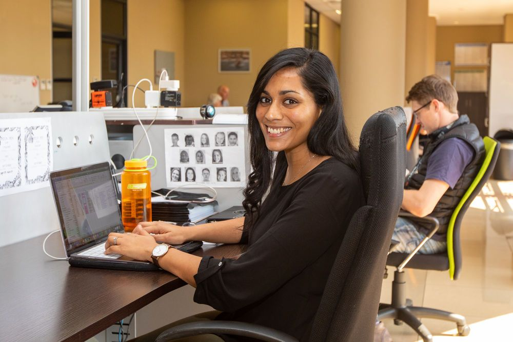 Vinitha Rodwell (Australia) working at her desk. Vinitha and her husband Nick, in the background, lead the Africa Trek and are passionate about equipping young people to be leaders and disciple-makers. Photo by Rebecca Rempel
