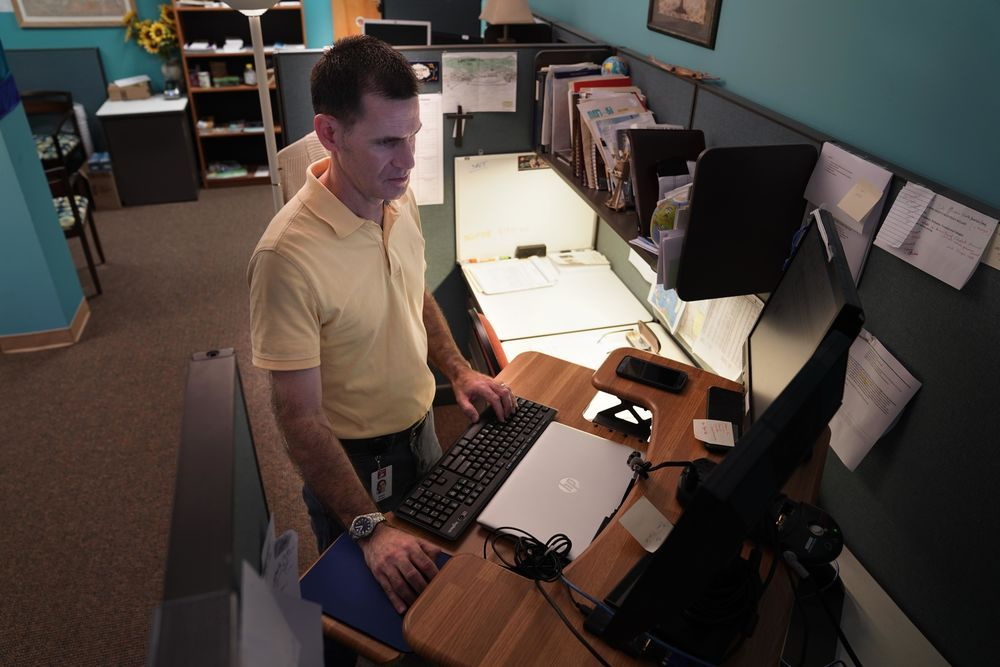 Matt in his office working through documents for OM in the Caribbean. Photo by Alex Arpag