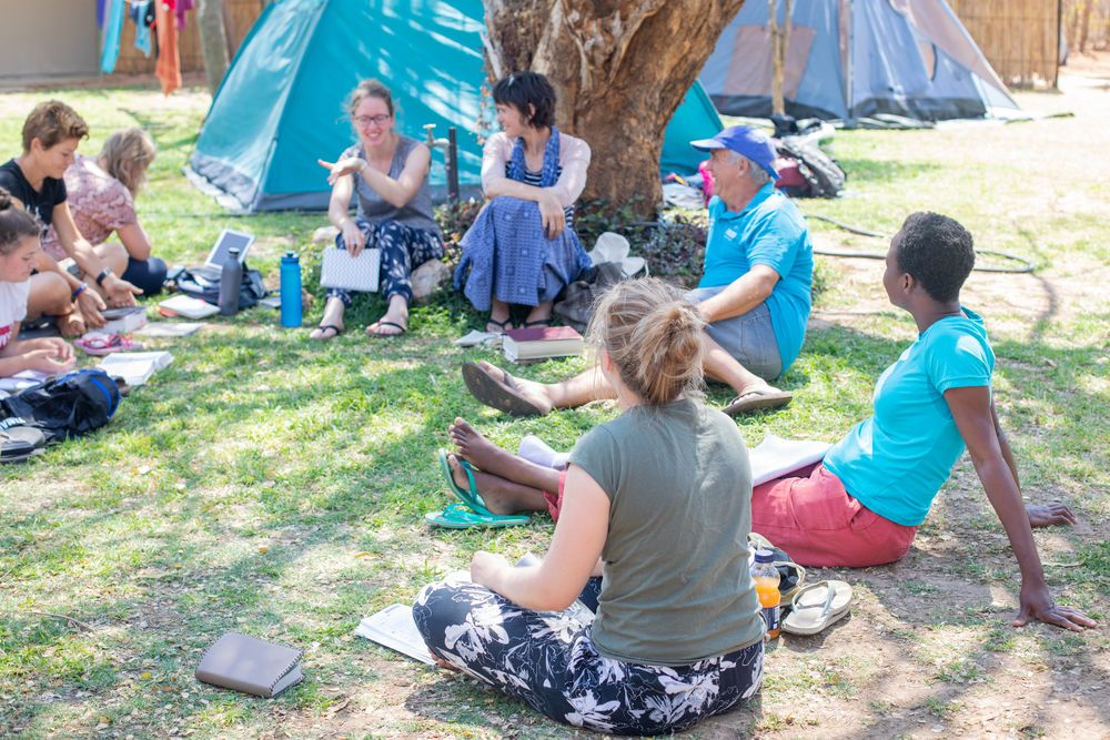 Namibia: Luke 24 participants do a Bible study together. The Luke 24 Journey is a month-long programme in Namibia that focuses on hearing God's voice and living by faith and obedience. With no set schedule, the group asks and trusts the Lord for direction and guidance. Photo by Rebecca Rempel More Info
