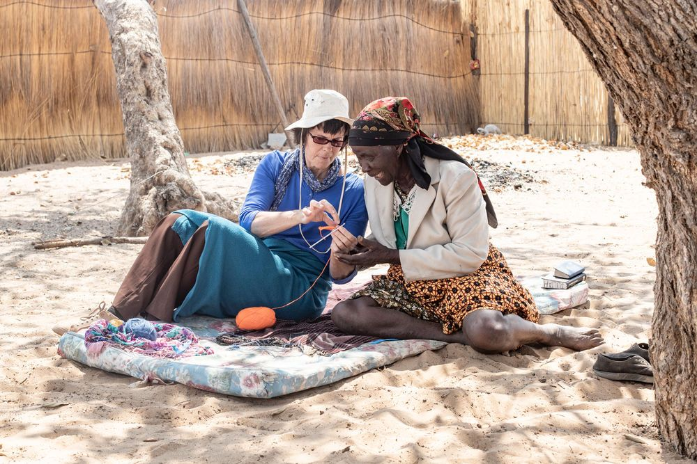 Namibia: Ronel, left, shows a lady how to crochet in a village in Namibia. Photo by Rebecca Rempel. More Info